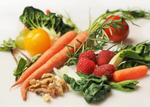 an assortment of fresh organic vegetables on a table
