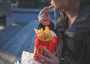 a woman eating mcdonalds fries