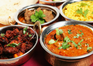 different bowls of indian curry dishes