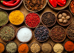 flatlay of different bowls of spices used in curries