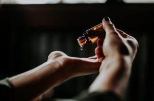 Woman putting essential oils in her palm