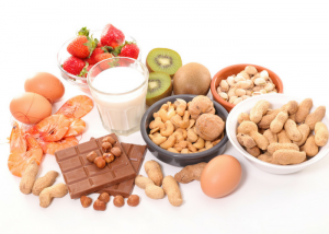 common allergy foods like milk, kiwi, eggs, nuts, strawberries, and prawns