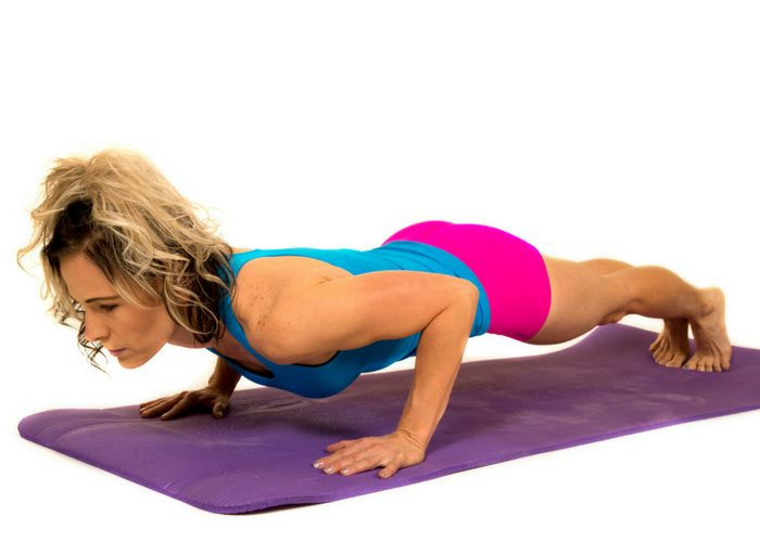 Woman doing a scapula bodyweight back exercise