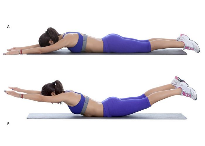 Woman demonstrating how to do the superman lower back exercise in two steps