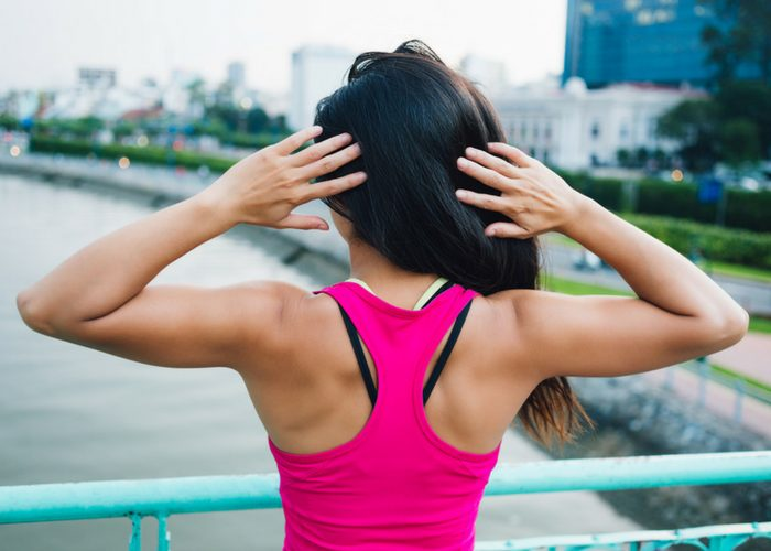 The toned back of a woman in fitness gear