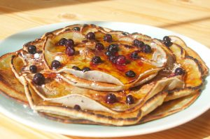 Cassava flour pancakes topped with blueberries