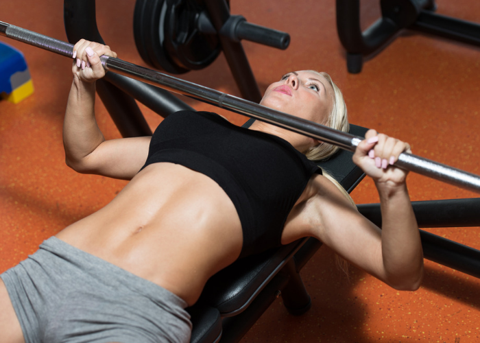 woman doing chest press with weights