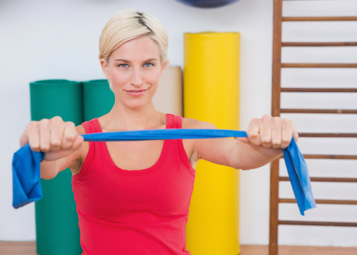 woman doing simple pectoral fly chest exercises