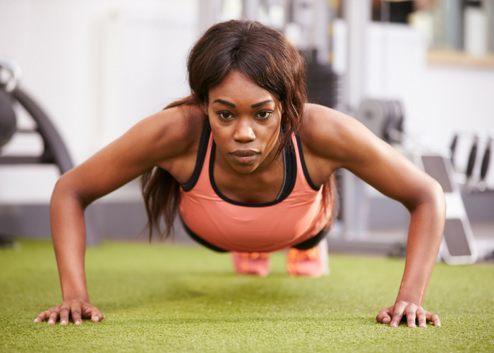 woman doing wide push up chest exercises