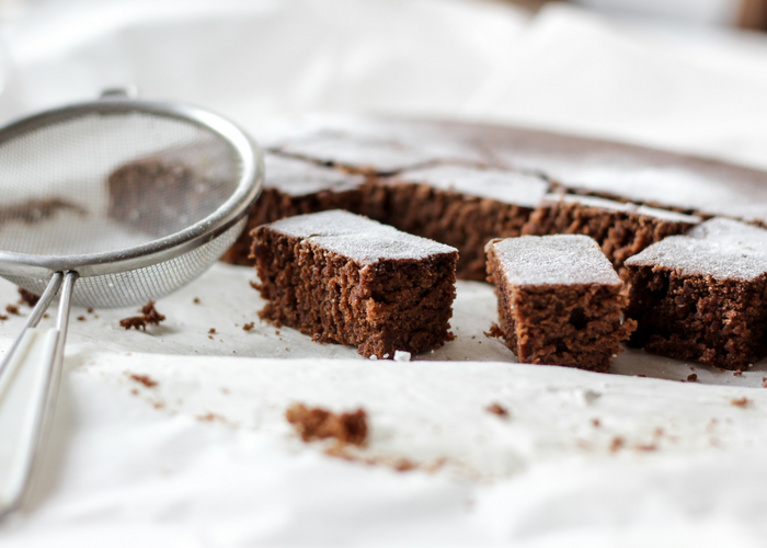 cocoa brownie bites on a white sheet
