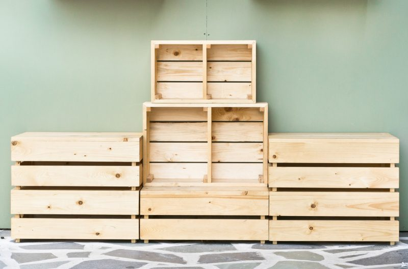 A stack of empty wooden crates against a wall