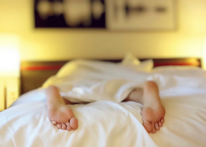 woman's feet at the end of the bed