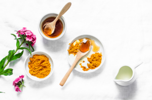 Natural face mask ingredients such as turmeric powder, honey and milk