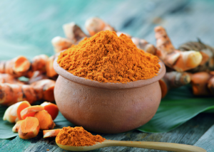 turmeric powder in a small clay pot