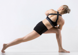 woman doing lunge and twist dynamic stretch