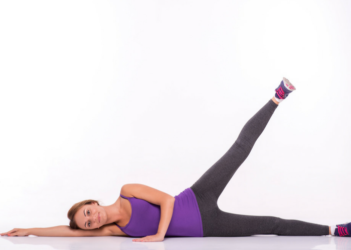 woman doing side leg raises for leg exercise