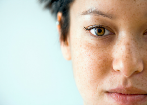 woman with brown eyes and freckles