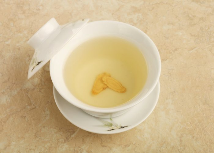 a cup of homemade ginseng and lemon tea