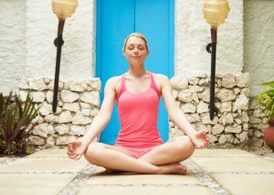 woman in a meditation position showing that comfort is a key meditation tip