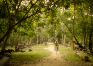 woman practicing walking meditation in the woods
