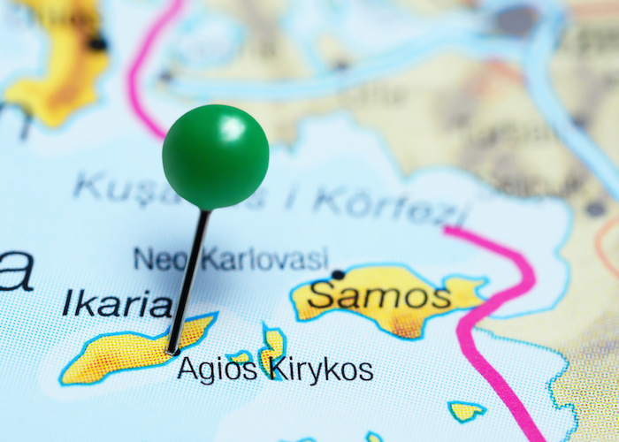 a green pin stuck in the location of Ikaria on a map, where many people live to 100