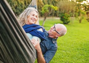 old couple relaxing in a hammock
