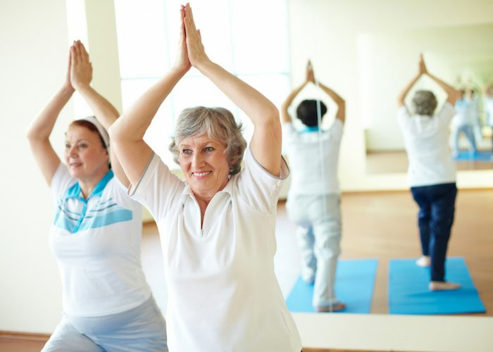 elderly women in a yoga class