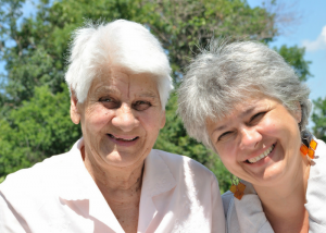 old ladies with white and greying hair smiling