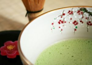matcha green tea mixture in a floral bowl