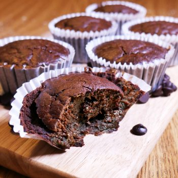 Fresh sorghum flour cocoa cupcakes on a wooden board