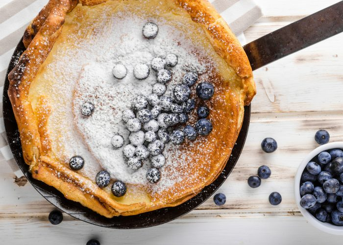 oven bake sorghum flour pancakes topped with sugar dusting and blueberries
