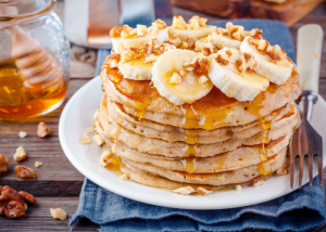 gluten free pancakes topped with bananas and sorghum syrup