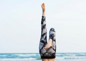 shot of a woman's feet up in the air with stylish fitness pants