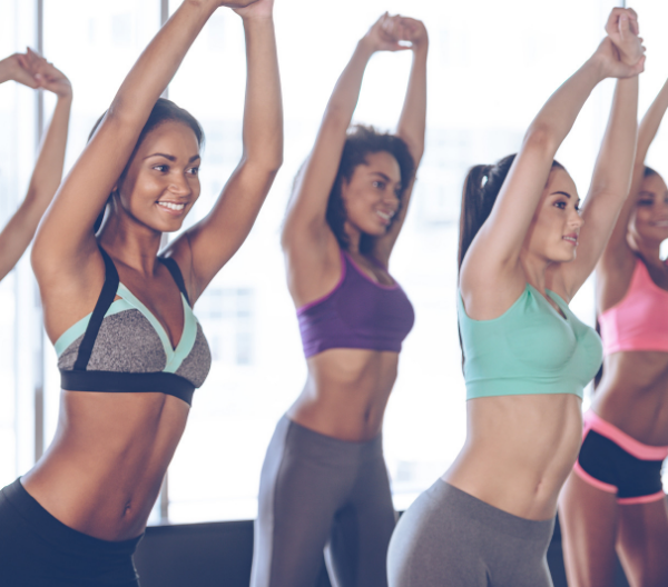 group of women in a fitness class wearing stylish workout gear