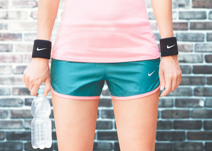 a woman modeling nike activewear workout gear for women