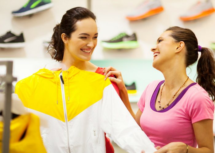 two females shopping for sportswear for women