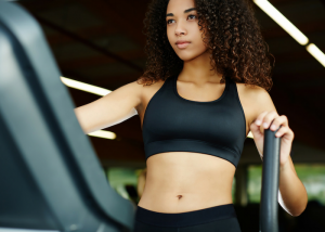 woman working out at the gym in a black sports bra