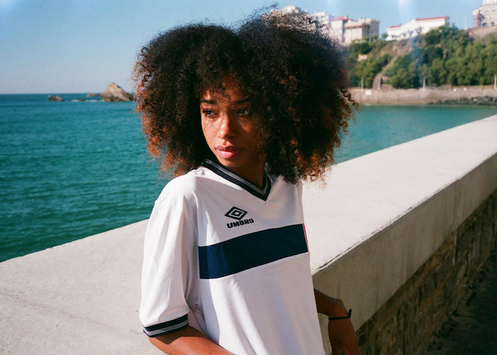 woman in an umbro jersey