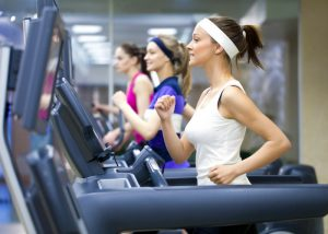women running on treadmills in the gym