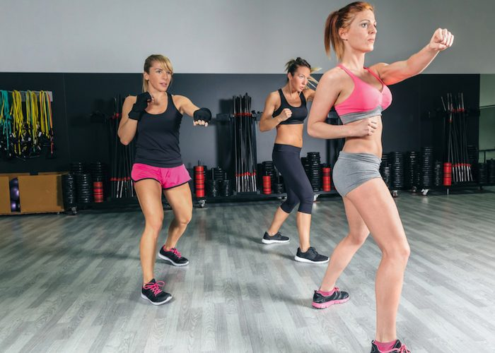 three women doing boxing exercises as a gym alternative