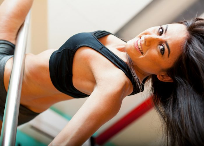 woman doing pole dancing as a gym alternative