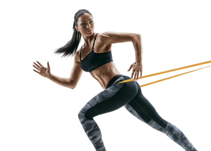 woman doing resistance band training workout without the gym