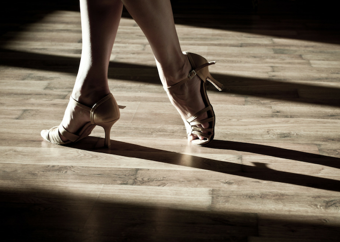 close up of a woman's feet in salsa shoes