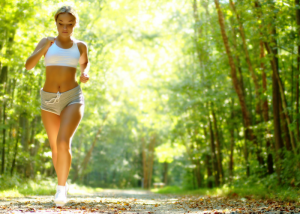 woman jogging in the woods and getting a workout without the gym