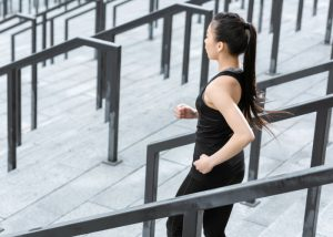 woman running down stairs outdoors having a workout without the gym