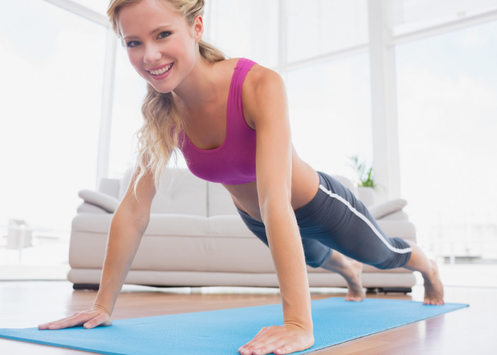 woman in plank position trying to tone her abs