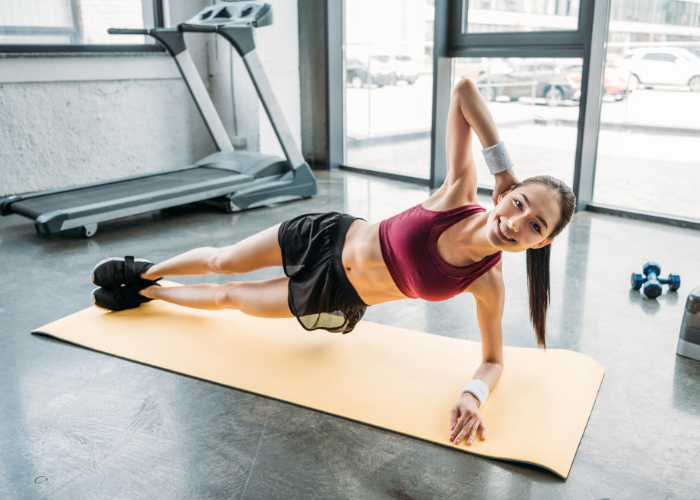 woman doing side plank twist ab exercises