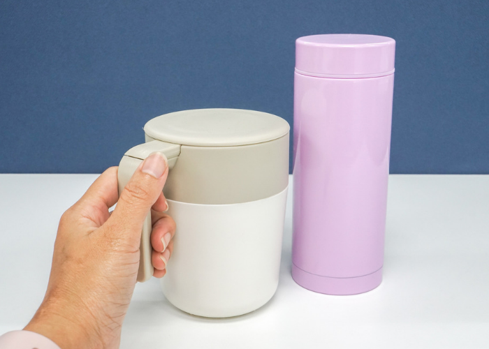 a thermos cup and pink thermos flask that contain DIY lunch