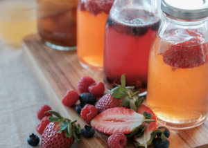 Homemade bottles of probiotic rich kombucha infused with fruits