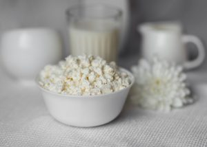 Probiotic-rich homemade cottage cheese in a white bowl